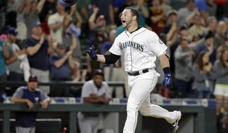 Seattle Mariners' Mike Zunino tosses his batting helmet as he heads home on his two-run home run, scoring the winning run against the Minnesota Twins in the ninth inning of a baseball game Wednesday, June 7, 2017, in Seattle. The Mariners won 6-5. (AP Photo/Elaine Thompson)