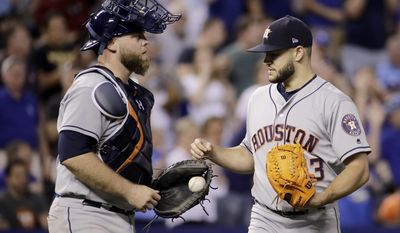 Houston Astros starting pitcher Lance McCullers Jr. talks to catcher Brian McCann after giving up the first hit of the baseball game by the Kansas City Royals, during the seventh inning Thursday, June 8, 2017, in Kansas City, Mo. (AP Photo/Charlie Riedel)