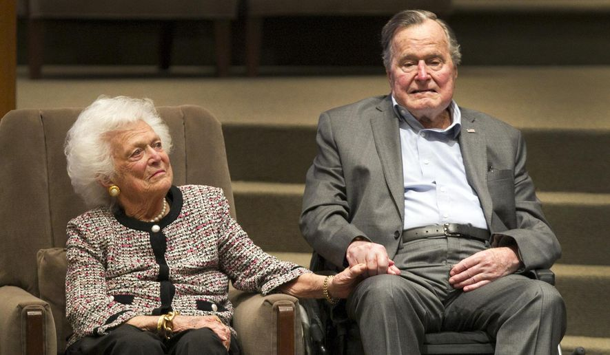In this March 8, 2017, file photo, former President George H.W. Bush and former first lady Barbara Bush attend an awards ceremony hosted by Congregation Beth Israel after the Mensch International Foundation presented its annual Mensch Award to the former president in Houston. (Steve Gonzales/Houston Chronicle via AP, File)