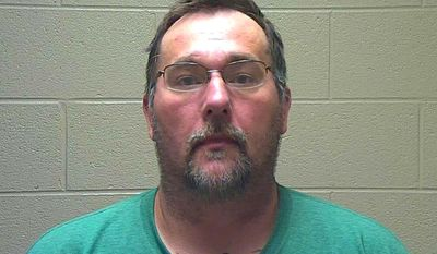 """This undated photo provided by the Coffee County Sheriff's Department shows a mug shot of David Brady, of New York. Brady is accused of bringing more than 100 fake drugs to the Bonnaroo music festival in Tennessee. Authorities say he told deputies he was doing """"God's Work"""" by bringing the fake drugs to the event. (Coffee County Sheriff's Department via AP)"""