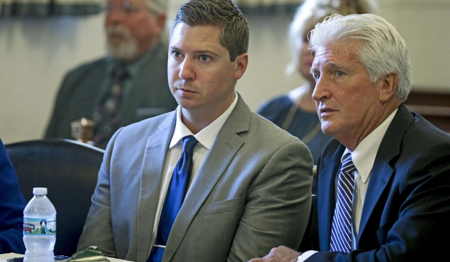 Ray Tensing, center, and his defense attorney Stewart Mathews, right, listen to assistant prosecutor Stacey DeGraffenreid's opening statement during Tensing's retrial Thursday, June 8, 2017, at the Hamilton County Courthouse in Cincinnati. During the opening statements in the former University of Cincinnati police officer's retrial, DeGraffenreid told Ohio jurors that evidence will show the 2015 shooting of unarmed black motorist Sam DuBose was clearly murder, while Mathews said Tensing feared for his life. (Cara Owsley/The Cincinnati Enquirer via AP, Pool)