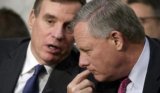 Senate Intelligence Committee Chairman Richard Burr, R-N.C., right, and Vice Chairman Mark Warner, D-Va., confer as former FBI director James Comey testifies on Capitol Hill in Washington, Thursday, June 8, 2017.  (AP Photo/J. Scott Applewhite)