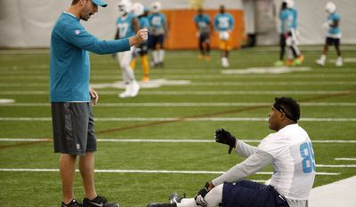 Miami Dolphins head coach Adam Gase, left, talks with tight end Julius Thomas during NFL organized team activities, Thursday, June 8, 2017 at the Dolphins training facility in Davie, Fla. (AP Photo/Wilfredo Lee)