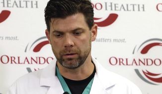 FILE-This June 14, 2016 file photo shows Dr. Chadwick Smith, one of the doctors that treated victims of the Pulse nightclub shooting, as he describes how he and others called for reinforcements that night, at a news conference at the Orlando Regional Medical Center, in Orlando, Fla. Smith is used to confronting human suffering head-on in the operating room. But the sheer number of victims that night, 49 dead, 53 wounded, and the flood of relatives to the hospital left its mark on even a veteran like Smith. (AP Photo/John Raoux, File)