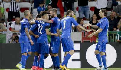 Italian players celebrate after Eder scored during a friendly soccer match between Italy and Uruguay, at the Nice Allianz Riviera stadium, France, Wednesday, June 7, 2017. (AP Photo/Claude Paris)
