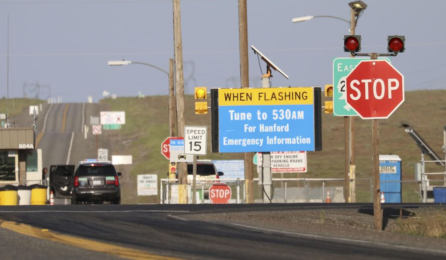 FILE--In this May 9, 2017, file photo, an emergency sign flashes outside the Hanford Nuclear Reservation near Richland, Wash. Radiation warning alarms sounded about 7 a.m., Thursday, June 8, 2017, outside the Plutonium Finishing Plant, prompting about 350 workers at the Reservation to seek cover indoors. (AP Photo/Manuel Valdes, file)