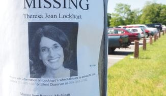 In this May 31, 2017 photo, a K9 search is conducted for Theresa Lockhart in Portage, Mich.   Lockhart went missing on May 18, after she was last seen driving away from her home in Portage around 10 p.m. Police said they found her car a few miles from her home at the park and ride on Angling Road and West Centre Avenue.   (Mark Bugnaski/Kalamazoo Gazette-MLive Media Group via AP)