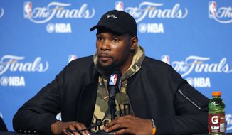 Golden State Warriors forward Kevin Durant speaks after Game 3 of basketball's NBA Finals between the Warriors and the Cleveland Cavaliers in Cleveland, early Thursday, June 8, 2017. (AP Photo/Ron Schwane)