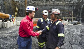 George Dethlefsen (lef), CEO of Corsa Coal Corp., said President Trump's deregulation effort had brought jobs back to the struggling coal economy in western Pennsylvania. Last week, Corsa opened its first new deep mine in Pennsylvania in six years. (Associated Press)