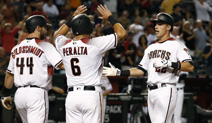 Arizona Diamondbacks' Jake Lamb, right, celebrates his three-run home run against the San Diego Padres with David Peralta (6) and Paul Goldschmidt (44) during the third inning of a baseball game Wednesday, June 7, 2017, in Phoenix. (AP Photo/Ross D. Franklin)