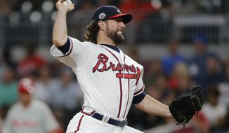 Atlanta Braves starting pitcher R.A. Dickey works against the Philadelphia Phillies during the seventh inning of a baseball game Thursday, June 8, 2017, in Atlanta. (AP Photo/John Bazemore)