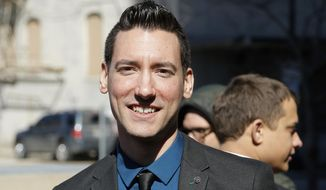 In this Feb. 4, 2016, file photo, David Daleiden, one of the two indicted anti-abortion activists, speaks with supporters outside the Harris County Criminal Courthouse after turning himself in to authorities in Houston. The leader of an anti-abortion group moved to disqualify a federal judge who barred him from releasing videos recorded at meetings of an association of abortion providers. (AP Photo/Bob Levey, File)