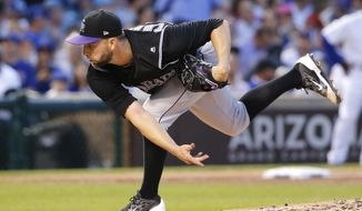 Colorado Rockies starting pitcher Tyler Chatwood follows through on a pitch during the third inning of the team's baseball game against the Chicago Cubs on Thursday, June 8, 2017, in Chicago. (AP Photo/Charles Rex Arbogast)