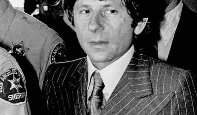 FILE - In this Aug. 8, 1977 file photo, director Roman Polanski appears in a Santa Monica, Calif., courthouse. A lawyer for Polanski says his sex crime victim will appeal to a judge to end the case against him. Attorney Harland Braun said Samantha Geimer will appear Friday, June 9, 2017 in Los Angeles Superior Court to help make the case that Polanski has served his time for the 40-year-old crime. (AP Photo/File)