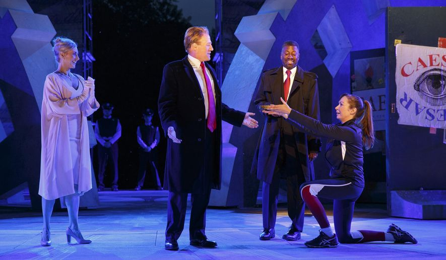 In this May 21, 2017 photo provided by The Public Theater, Tina Benko, left, portrays Melania Trump and Gregg Henry, center left, portrays President Donald Trump in the role of Julius Caesar during a dress rehearsal of The Public Theater's Free Shakespeare in the Park production of Julius Caesar, in New York. Rounding out the cast on stage is Teagle F. Bougere, and Elizabeth Marvel. (Joan Marcus/The Public Theater via AP)