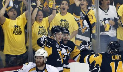 Pittsburgh Penguins' Bryan Rust, center, celebrates his goal against the Nashville Predators with Olli Maatta, left, and Chris Kunitz, right, during the first period in Game 5 of the NHL hockey Stanley Cup Final, Thursday, June 8, 2017, in Pittsburgh. (AP Photo/Gene J. Puskar)