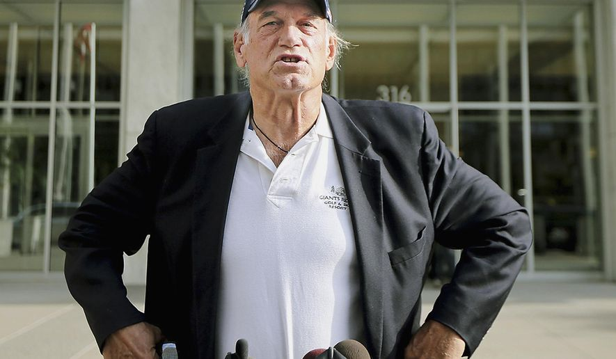 """FILE - In this Oct. 20, 2015, file photo, former Minnesota governor and professional wrestler Jesse Ventura talks to reporters outside the federal building in St. Paul, Minn. Ventura has a new commentary show on Russian state television called """"The World According to Jesse."""" It's expected to being airing soon on RT America, the Washington arm of the international network RT. (Elizabeth Flores/Star Tribune via AP, File)"""
