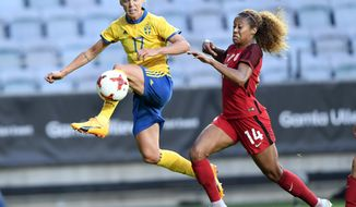 Sweden's Caroline Seger, left, vies for the ball with Casey Short of the USA, during the women's international friendly soccer match between Sweden and the USA, at Gamla Ullevi stadium in Goteborg, Sweden, Thursday, June 8, 2017. (Bjorn Larsson Rosvall/TT via AP)