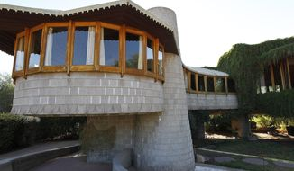 FILE - This Oct. 19 2012 file photo shows a home designed by noted architect Frank Lloyd Wright in Phoenix. The house that the famous architect designed for his son is being donated to the school bearing his name years after it was salvaged from demolition. (AP Photo/Ross D. Franklin, file)
