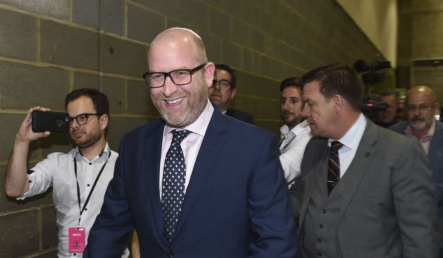 U.K. Independence Party leader Paul Nuttall smiles as he walks through the Peter Paine Performance Centre in Boston, England after losing the Boston and Skegness seat in the general election Friday June 9, 2017. UKIP's vote has collapsed in the election, with former supporters going to both Labour and the Conservatives. The party looks unlikely to win any seats in the House of Commons.  (Joe Giddens/PA via AP)