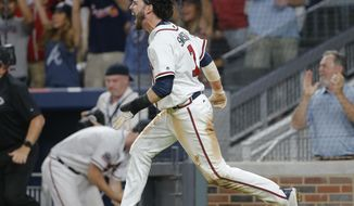 Atlanta Braves' Dansby Swanson (7) yells after scoring the game-winning run on a Rio Ruiz base hit during the ninth inning of a baseball game against the New York Mets Friday, June 9, 2017, in Atlanta. Atlanta won 3-2. (AP Photo/John Bazemore)