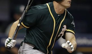 Oakland Athletics' Jaycob Brugman grounds out against the Tampa Bay Rays during the seventh inning of a baseball game Friday, June 9, 2017, in St. Petersburg, Fla., in Brugman's debut game in the majors. (AP Photo/Chris O'Meara)