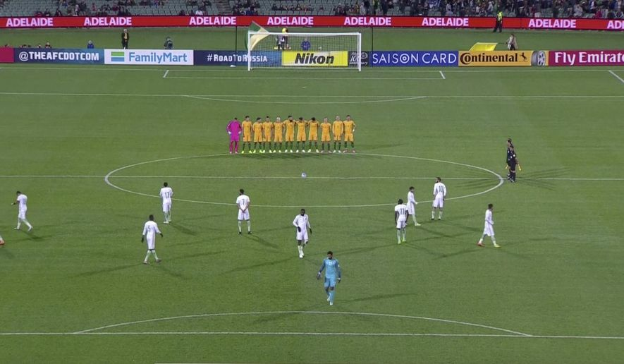 "In this image made from Thursday, June 8, 2017, video provided by Lagardere Sports, players from the Saudi Arabian team walk on the field as Australian players line up for a minute of silence before the start of a World Cup qualifying match in Adelaide, Australia. The Saudi Arabian Football Federation has apologized for ""any offense caused"" after its players declined to participate in a minute's silence in memory of last weekend's deadly attacks in London before the start of a World Cup qualifying match against Australia. (Lagardere Sports via AP)"