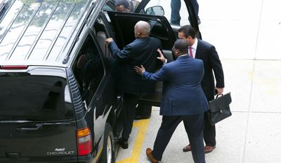 Publicist Andrew Wyatt, center, help actor Bill Cosby, left, into a vehicle after leaving the courthouse at the end of the fourth day of the Bill Cosby sexual assault trial at the Montgomery County Courthouse on June 8, 2017, in Norristown, Pa. (Eduardo Munoz Alvarez/Pool Photo via AP)