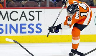 FILE - In this April 9, 2017, file photo, Philadelphia Flyers' Sean Couturier breaks his stick while taking a shot on a break away during the second period of an NHL hockey game against the Carolina Hurricanes in Philadelphia.  Despite technological advances that turn carbon fiber into one-piece, fine-tuned machines that are custom made for each NHL player to become extensions of their hands, hockey sticks can still break.  And, sometimes it happens at the worst times. (AP Photo/Tom Mihalek, File)