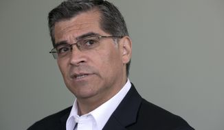 "California Attorney General Xavier Becerra blasted his former congressional colleague, House Speaker Paul Ryan, who suggested that President Donald Trump's lack of political experience helps explain his questionable interactions with James Comey when he was FBI director, during an interview with The Associated Press, Friday, June 9, 2017, in Sacramento, Calif. Becerra labeled Ryan an ""accomplice"" for defending what he termed Trump's incompetence or dereliction of his presidential duties. (AP Photo/Rich Pedroncelli)"