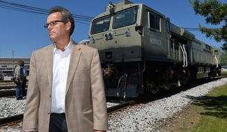 ADVANCE FOR RELEASE SATURDAY, JUNE 10, 2017, AT 3:01 A.M. EDT. AND THEREAFTER - In this June 1, 2017 photo, Richard Simpson, vice president for global supply chain for GE Transportation poses beside a dual-cab, 4,500-horsepower Evolution Series locomotive  built for India Railways, in Lawrence Park Township, Erie County, Pa. It's one of two currently at GE Transportation's plant. GE Transportation has agreed to a 1,000-locomotive order with India Railways. (Christopher Millette/Erie Times-News via AP)