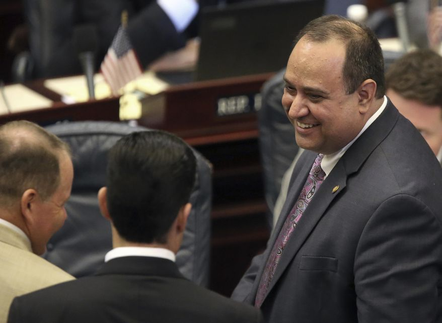 Rep. Ray Rodrigues, R-Estero, right, celebrates with his fellow members as the medical marijuana bill he sponsored was passed during session, Friday, June 9, 2017, in Tallahassee, Fla. (AP Photo/Steve Cannon)