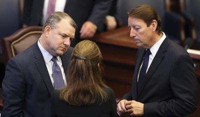 From left to right, senators Rob Bradley, R-Fleming Island, Denise Grimsley, R-Lake Placid, and Bill Galvano, R-Bradenton, confer during session, Friday, June 9, 2017, in Tallahassee, Fla. (AP Photo/Steve Cannon)