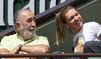 Romanian tennis legend Ion Tiriac and finalist Romania's Simona Halep watch Switzerland's Stan Wawrinka playing Britain's Andy Murray during their semifinal match of the French Open tennis tournament at the Roland Garros stadium, Friday, June 9, 2017 in Paris. (AP Photo/David Vincent)