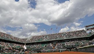 FILE - In this Monday, June 5, 2017 file photo Britain's Andy Murray serves against Russia Karen Khachanov during their fourth round match of the French Open tennis tournament at the Roland Garros stadium, in Paris, France. (AP Photo/Petr David Josek, File)