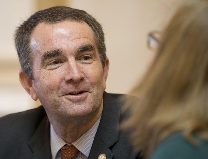 FILE - In this Thursday Jan. 26, 2016 photo, Virginia Lt. Gov., and Democratic candidate for Governor, Ralph Northam, left, as he talks with Senate Chief Deputy Clerk, Tara Perkinson, right, prior to the start of the Senate session at the Capitol in Richmond, Va. Virginia primary voters will select candidates for the nation's marquee race for governor, without any recommendations so far from President Donald Trump or former President Barack Obama on who to vote for. Northam, has the backing of the state party's establishment and particularly robust support among black political leaders who feel a strong connection with the country's first African-American president. (AP Photo/Steve Helber, File)