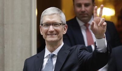 FILE - In this Thursday, Feb. 9, 2017 file photo, Apple CEO Tim Cook waves at members of the media as he leaves 10 Downing Street in London. Apple CEO Tim Cook is delivering the commencement address at the Massachusetts Institute of Technology. Cook is scheduled to address graduates and their families at midmorning Friday, June 9, 2017. (AP Photo/Matt Dunham)
