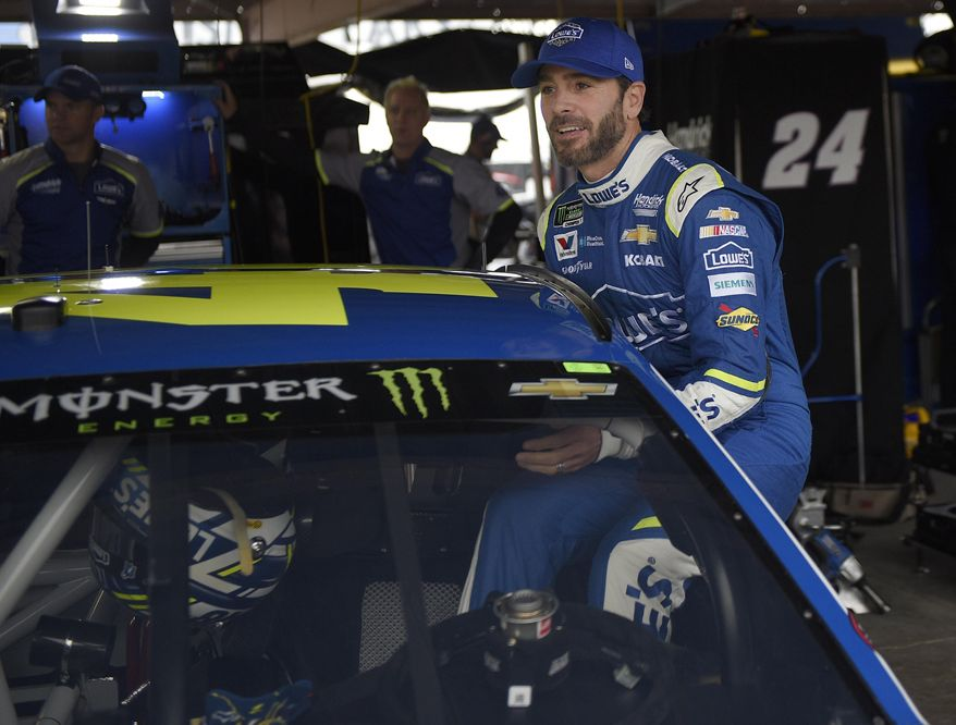 Jimmie Johnson climbs into his car before practice for the NASCAR Cup series auto race, Saturday, June 3, 2017, at Dover International Speedway in Dover, Del. (AP Photo/Nick Wass)