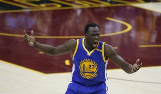 Golden State Warriors forward Draymond Green (23) reacts to a foul call during the first half of Game 4 of the basketball team's NBA Finals against the Cleveland Cavaliers in Cleveland, Friday, June 9, 2017. (AP Photo/Ron Schwane)