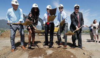 From left, Dick Celeste, chairman of the board of the U.S. Olympic Museum, joins Benita Fitzgerald Mosley, an Olympic Gold medalist, Colorado Springs, Colo., Mayor John Suthers, Colorado Governor John Hickenlooper and Scott Blackmun, chief executive of the U.S. Olympic committee, during a ceremonial groundbreaking for a new Olympic museum Friday, June 9, 2017, in Colorado Springs, Colo. The $75-million project will be built just blocks away from the U.S. Olympic Committee headquarters an the U.S. Olympic Training Center and breathe new life into the city's core. (AP Photo/David Zalubowski)