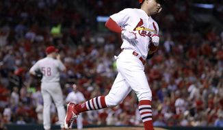 St. Louis Cardinals' Aledmys Diaz, right, rounds the bases after hitting a solo home run off Philadelphia Phillies starting pitcher Jeremy Hellickson during the fifth inning of a baseball game Friday, June 9, 2017, in St. Louis. (AP Photo/Jeff Roberson)