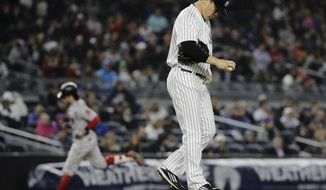 New York Yankees starting pitcher Masahiro Tanaka, of Japan, reacts as Boston Red Sox's Andrew Benintendi runs the bases after hitting a home run during the fifth inning of a baseball game Tuesday, June 6, 2017, in New York. (AP Photo/Frank Franklin II)