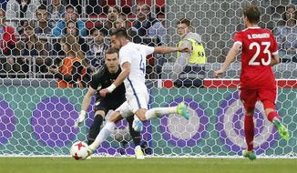 Chile's Mauricio Isla scores the goal past Russia's goalkeeper Igor Akinfeev during the international friendly soccer match between Russia and Chile at the VEB Arena stadium in Moscow, Russia, Friday, June 9, 2017. (AP Photo/Alexander Zemlianichenko)