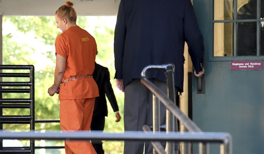Accused leaker Reality Winner leaves the U.S. District Courthouse in Augusta, Ga., following a bond hearing Thursday afternoon June 8, 2017.  U.S. Magistrate Judge Brian Epps denied bond Thursday for 25-year-old Reality Winner. Prosecutor Jennifer Solari says investigators seized a notebook from Winner's house in Augusta, Georgia, and in it, Winner made references about traveling to the Middle East (Michael Holahan/The Augusta Chronicle via AP)