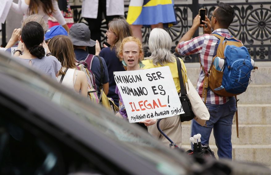 """""""Sanctuary"""" status was a hot topic this summer in Massachusetts, where the Supreme Judicial Court ruled that state and local authorities could no longer legally hold immigrants for pickup by U.S. Immigration and Customs Enforcement. (Associated Press/File)"""
