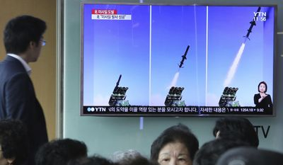 "A man watches a TV news program showing photos published in North Korea's Rodong Sinmun newspaper of North Korea's new type of cruise missile launch, at Seoul Railway station in Seoul, South Korea, Friday, June 9, 2017. North Korea said Friday it has tested a new type of cruise missile that could strike U.S. and South Korean warships ""at will"" if it is attacked, in an apparent reference to the projectiles detected by Seoul when they were launched a day earlier. (AP Photo/Ahn Young-joon)"
