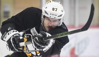Pittsburgh Penguins team captain Sidney Crosby shoots the puck Wednesday, June 7, 2017, during practice at the UPMC Lemieux Sports Complex in Cranberry, Pa., Wednesday, June 7, 2017.  The Penguins host the Nashville Predators in Game 5 of the NHL Stanley Cup hockey finals on Thursday. The best-of-seven series is tied  2-2.  (Peter Diana/Pittsburgh Post-Gazette via AP)
