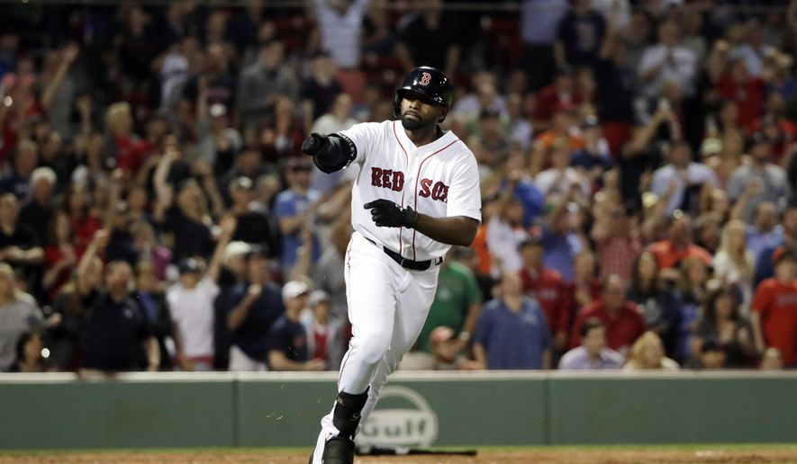 Boston Red Sox's Jackie Bradley Jr. gestures to his teammates after hitting a two-run home run against the Detroit Tigers during the eighth inning of a baseball game at Fenway Park, Friday, June 9, 2017, in Boston. (AP Photo/Elise Amendola)