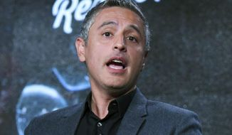 """FILE - In this Jan. 5, 2016 file photo, Reza Azlan speaks during the """"Rough Draft with Reza Aslan"""" panel at the Ovation 2016 Winter TCA in Pasadena, Calif.  CNN has dumped author Reza Aslan less than a week after he profanely referred to President Donald Trump in a tweet. The network, in a statement on Friday, June 9, 2017, said it was not continuing with a second season of Aslan's series, """"Believers,"""" which premiered last year and discussed different religions. (Photo by Richard Shotwell/Invision/AP, File)"""