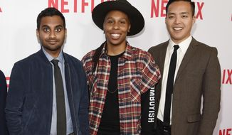 "FILE - In this May 18, 2016 file photo, Aziz Ansari, left, the star, writer, director and co-creator of the Netflix series ""Master of None,"" poses with cast members, Lena Waithe, center, and co-creator/executive producer Alan Yang at an Emmy For Your Consideration screening of the show in Beverly Hills, Calif. (Photo by Chris Pizzello/Invision/AP, File)"